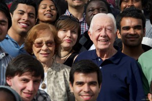 Juliano Saccomani (foreground, middle, 2012-2013, Fulbright FLTA from Brazil, meeting former President Jimmy Carter and First Lady Rosalynn Carter at a Georgia chapter Fulbright Association event