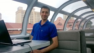 Fulbright-MTP Participant, Mohammad Behroozian, in the dome car of the Millennial Trains Project Train.